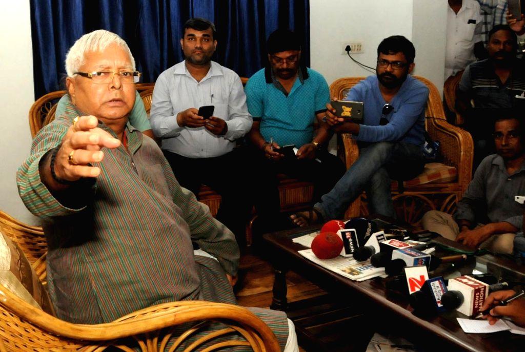 Rashtriya Janata Dal (RJD) Supremo Lalu Prasad Yadav addresses a press conference after the Central Bureau of Investigation carried out raids at 12 places in Patna, Delhi, Ranchi, Puri and ... - Lalu Prasad Yadav