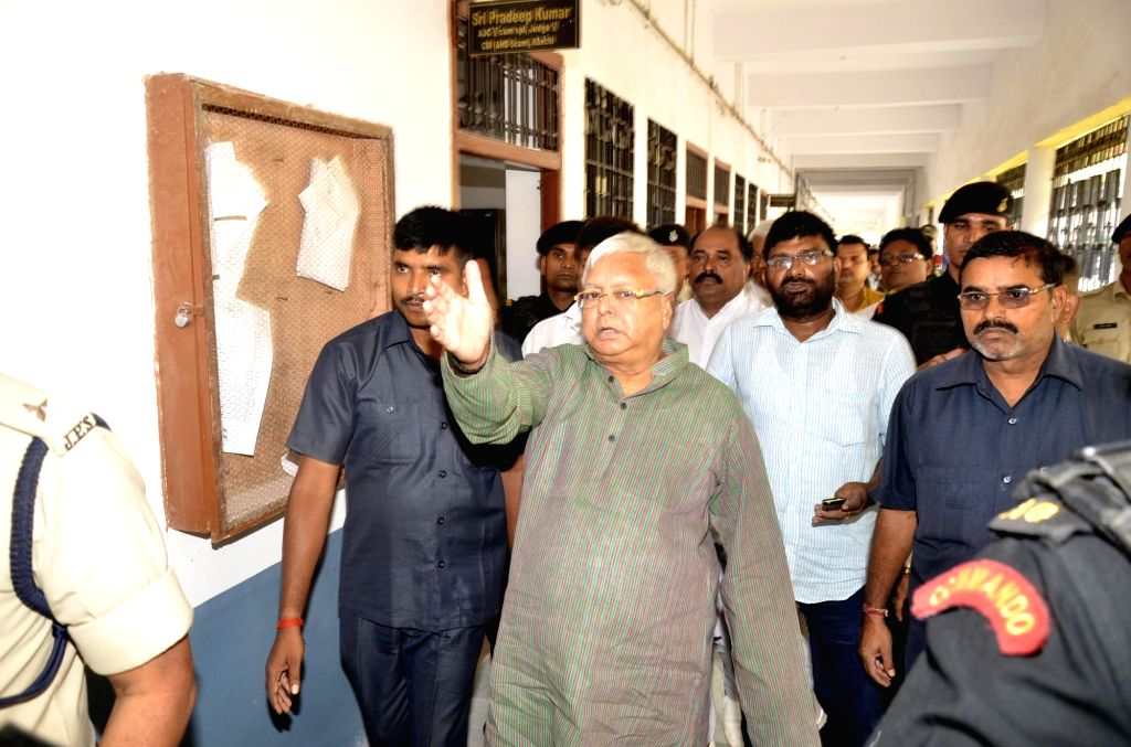 Rashtriya Janata Dal (RJD) Supremo Lalu Prasad Yadav arrives to appear before special CBI Court in connection with a multi-crore fodder scam case in Ranchi on July 7, 2017. - Lalu Prasad Yadav