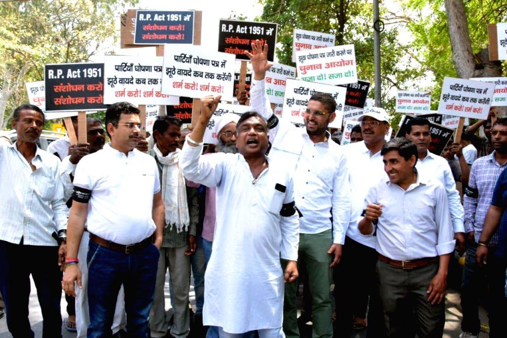 Rashtriya Janta Congress (RJC) National President Dr Sanjeeev Goel stage a demonstration demanding ''Election manifesto should be a legal mandate'' for permanant solutions for fake ...