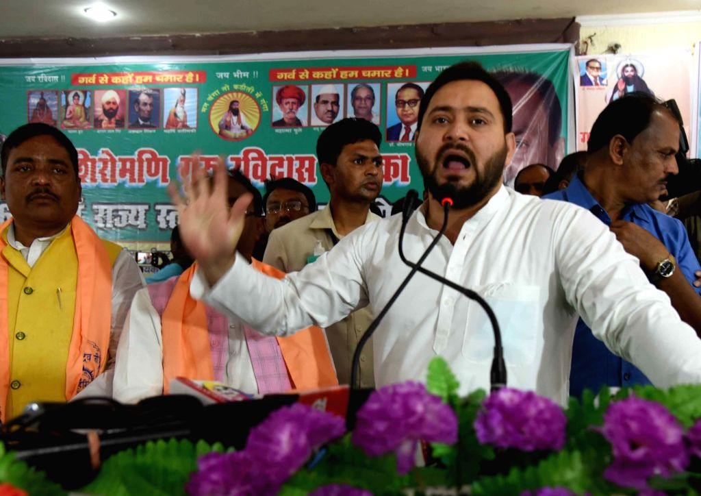Rashtriya Janta Dal leader Tejaswi Yadav being felicitate by Party leaders during the Ravidas Birth anniversary in Patna Saturday 06th March, 2021. - Tejaswi Yadav