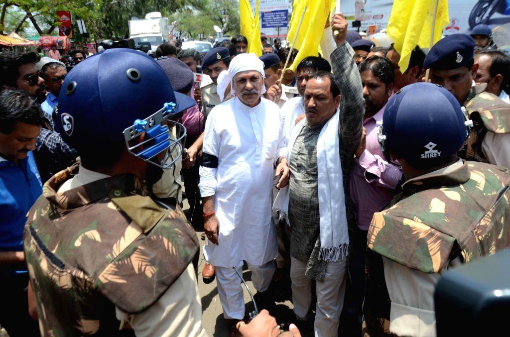 Rashtriya Kisan Mazdoor Sangh National Convener Shivkumar Sharma being arrested in Bhopal, on June 16, 2017.