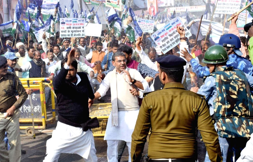 Rashtriya Lok Samata Party (RLSP) activists clash with security personnel during a protest to press for their demands in Patna, on Feb 2, 2019.