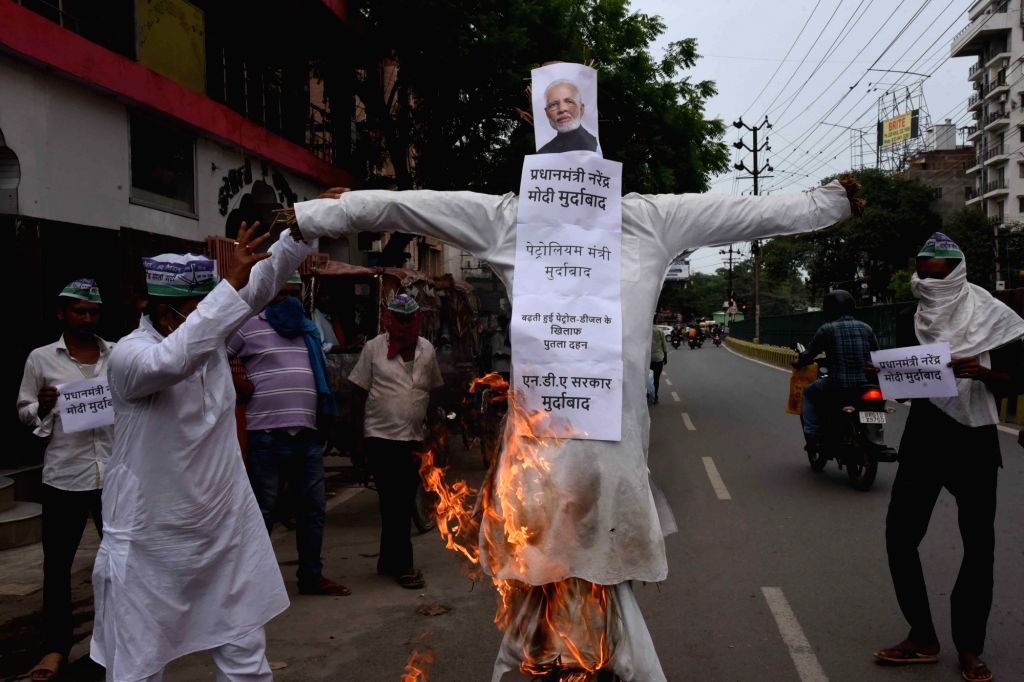 Rashtriya Lok Samata Party (RLSP) workers burn an effigy of Prime Minister Narendra Modi as they protest against hike in the prices of petrol and diesel, in Patna on June 24, 2020. - Narendra Modi
