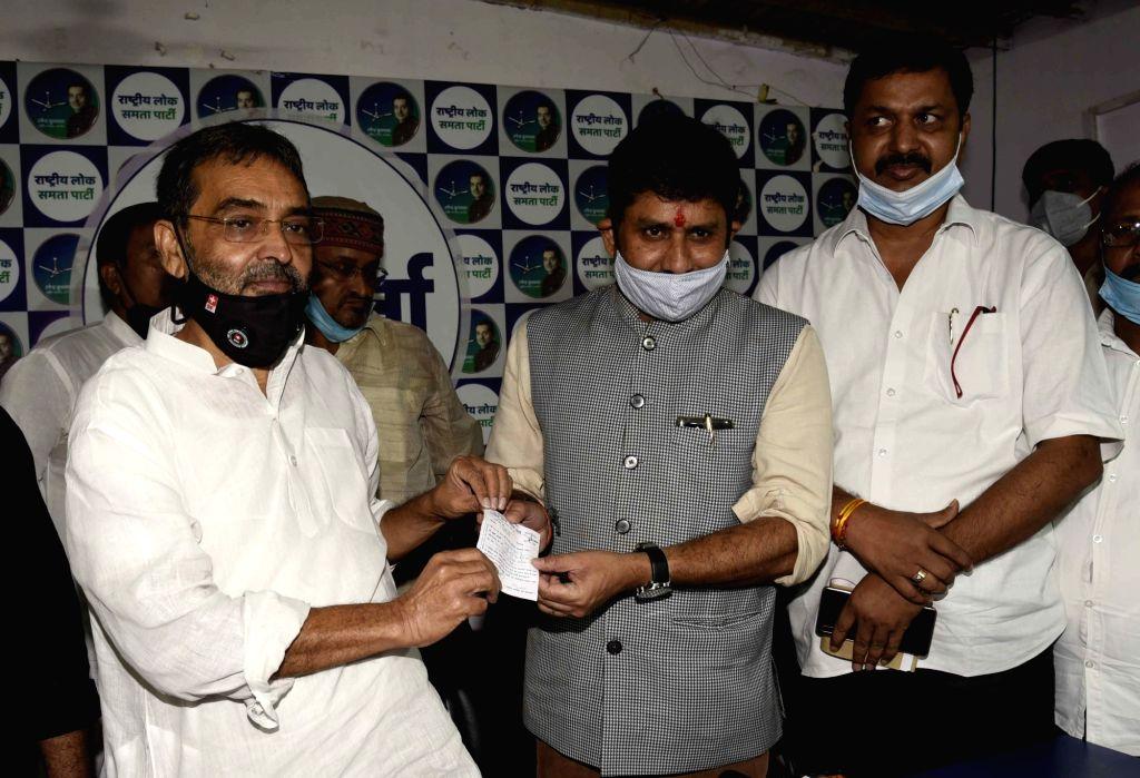 Rashtriya Lok Samta Party (RLSP) President Upendra Kushwaha presents membership slip to BJP MLA Ajay Pratap Singh as he joins RLSP ahead of Bihar Assembly elections, in Patna on Oct 6, 2020. - Ajay Pratap Singh
