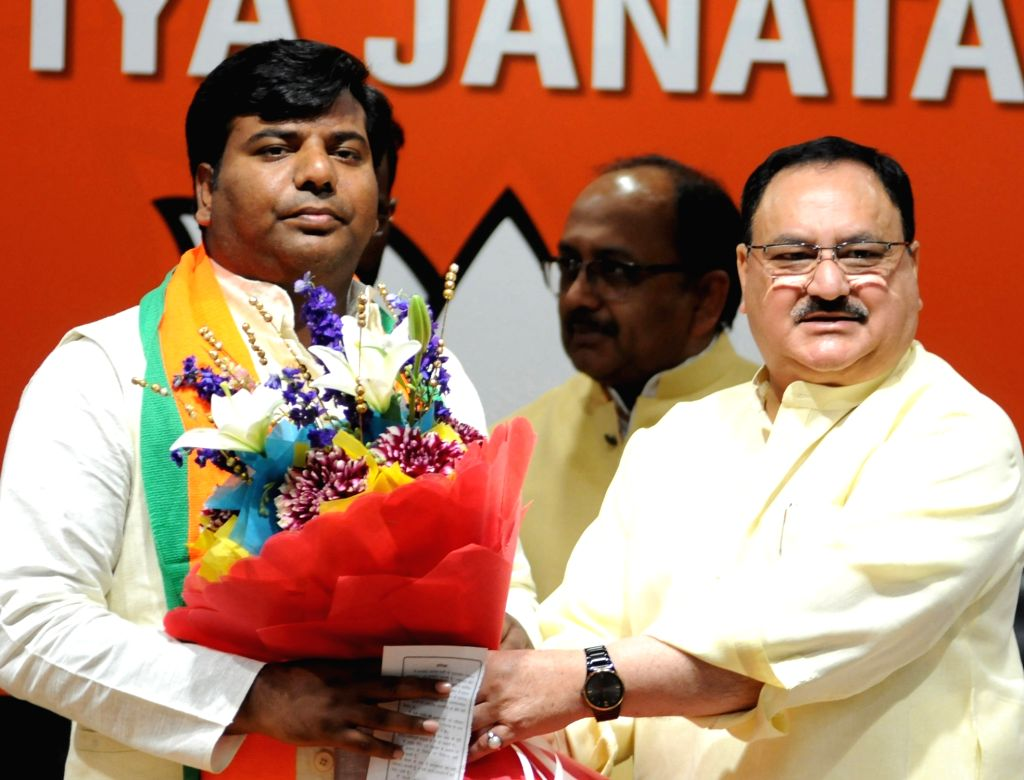 Rashtriya Nishad Party MP from Gorakhpur, Praveen Nishad joins BJP in the presence of Union Minister and party leader J.P. Nadda, in New Delhi on April 4, 2019. Nishad Party had earlier ...