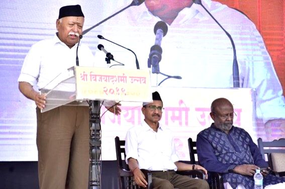 Rashtriya Swayamsevak Sangh (RSS) chief Mohan Bhagwat addresses members during a programme organised on the occasion of Foundation day celebrations and Vijayadashami at RSS headquarters in ...