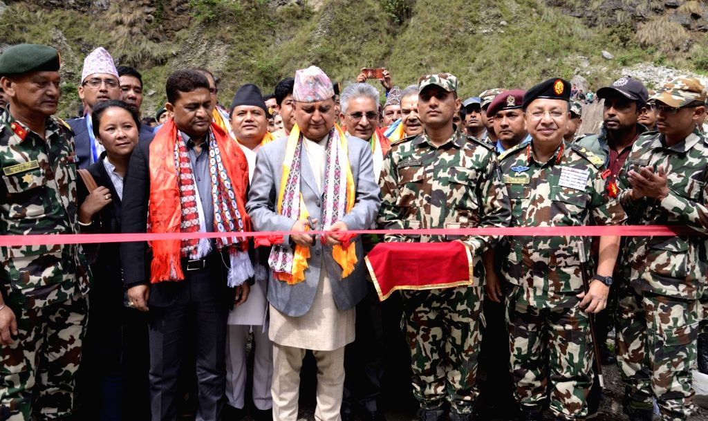 RASUWA, May 21, 2018 - Nepal's Defense Minister Ishwar Pokharel (C) inaugurates the newly opened  track of Mailung-Syaphrubesi road section constructed by Nepal Army in Rasuwa, Nepal, May 20, 2018. ... - Ishwar Pokharel