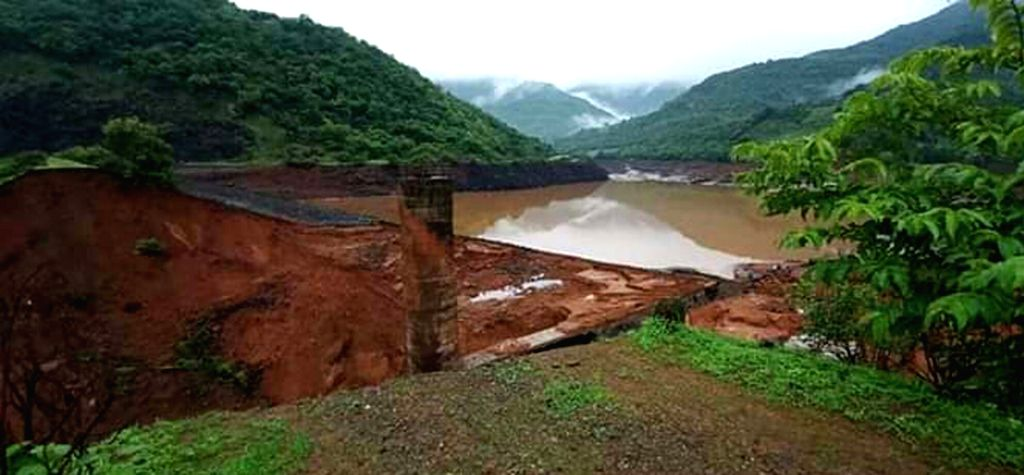 Ratnagiri: A view of the inundated area near the Tivare dam started overflowing after heavy rains and breached around 9.30 p.m near Bhendewadi hamlet following torrential downpour, in Maharashtra's Ratnagiri, on July 3, 2019. At least seven persons w