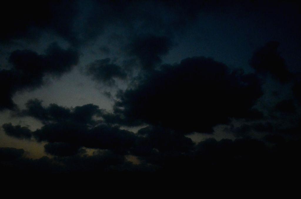Ratnagiri (Maharashtra): Dark clouds hover in the sky on an overcast day at Rajapur in Ratnagiri district of Maharashtra.