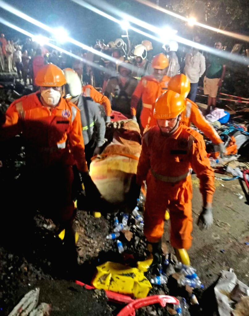 Ratnagiri: NDRF personnel carry out rescue operations after Tivare dam burst near Bhendewadi hamlet following torrential downpour, in Maharashtra's Ratnagiri, on July 3, 2019. At least seven persons were killed and 20 went missing after the dam start