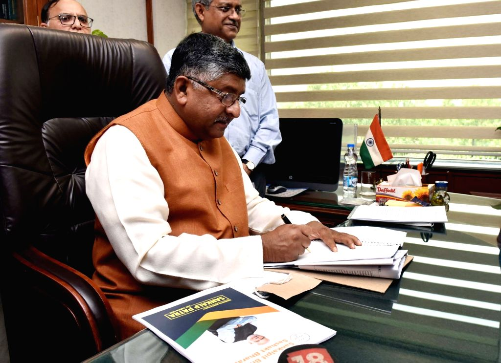 Ravi Shankar Prasad takes charge as the Union Minister for Law and Justice, in New Delhi on June 3, 2019.