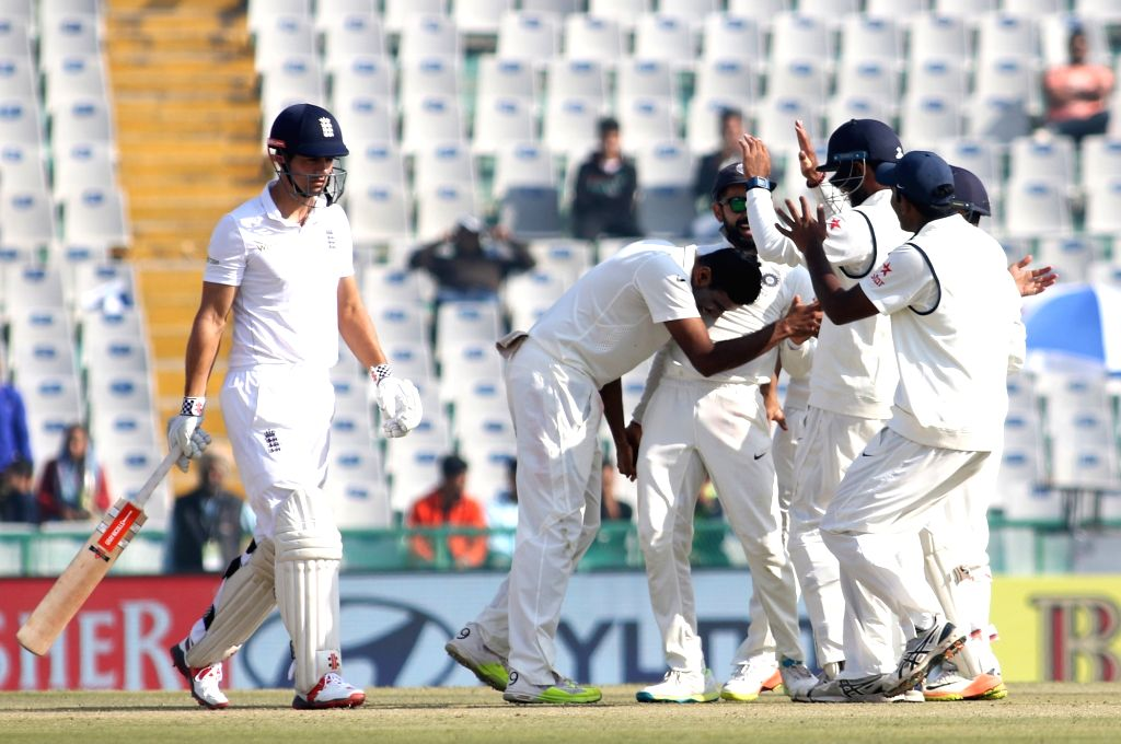 Ravichandran Ashwin of India celebrates the wicket of Alastair Cook, Captain of England during day 1 of the third test match between India and England held at the Punjab Cricket Association ...