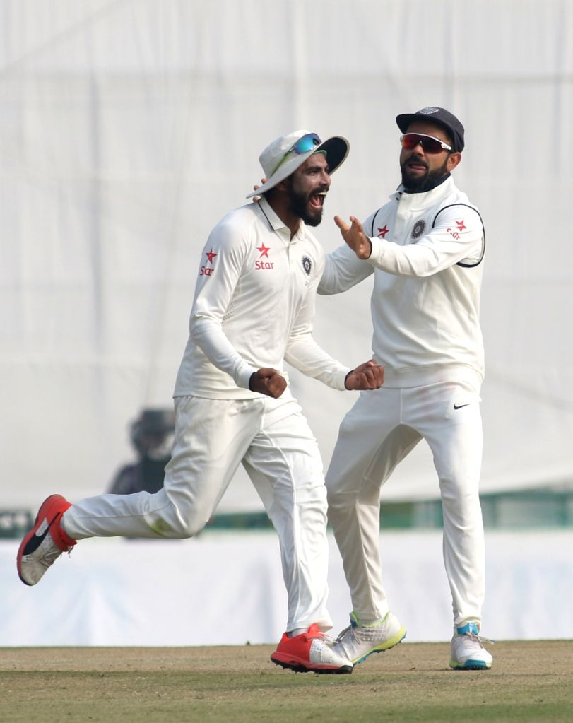 Ravindra Jadeja and Virat Kohli  of India celebrate fall of Jos Buttler's wicket on Day 4 of the third test match between India and England at Punjab Cricket Association IS Bindra Stadium, ... - Ravindra Jadeja and Virat Kohli