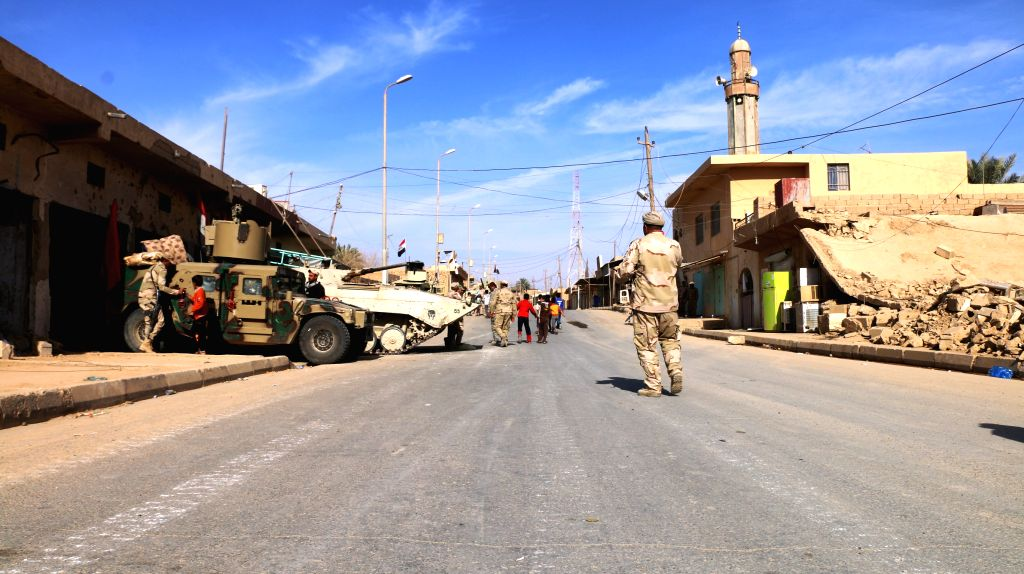 RAWA, Nov. 18, 2017 (Xinhua) -- Iraqi soldiers are seen in the liberated city of Rawa near the Iraqi border with Syria, on Nov. 18, 2017. Iraqi security forces battling Islamic State (IS) militants freed Friday the city of Rawa near the border with S