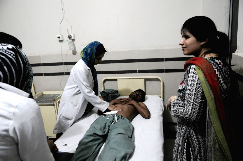 An injured man receives medical treatment at a hospital in Rawalpindi, adjacent city of Islamabad, capital of Pakistan, June 21, 2014. At least 41 people were ...