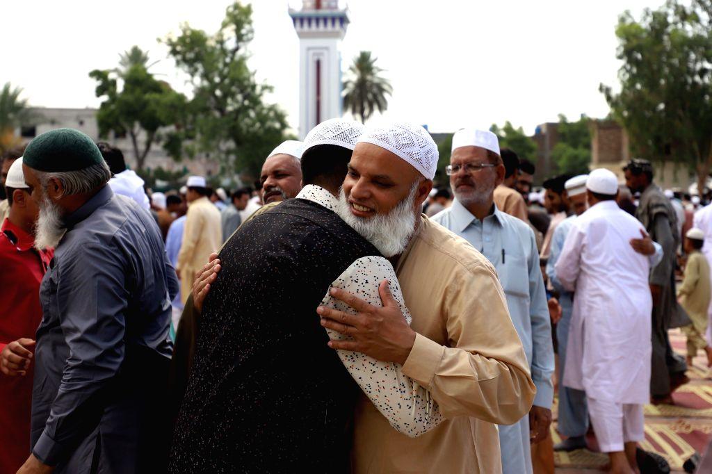 RAWALPINDI, June 5, 2019 - Muslims greet each other after offering prayers during Eid al-Fitr at the Eidgah Sharif in Rawalpindi, Pakistan on June 5, 2019.