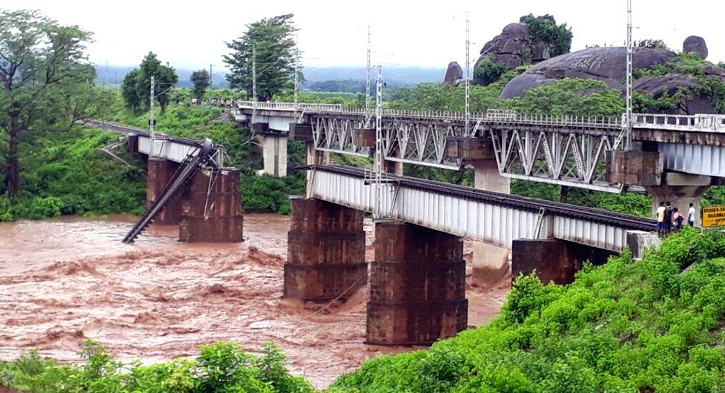 Rayagada: A view of a railway bridge over Nagabali river that was damaged in flash floods in Rayagada district of Odisha on July 17, 2017. (Photo: IANS)