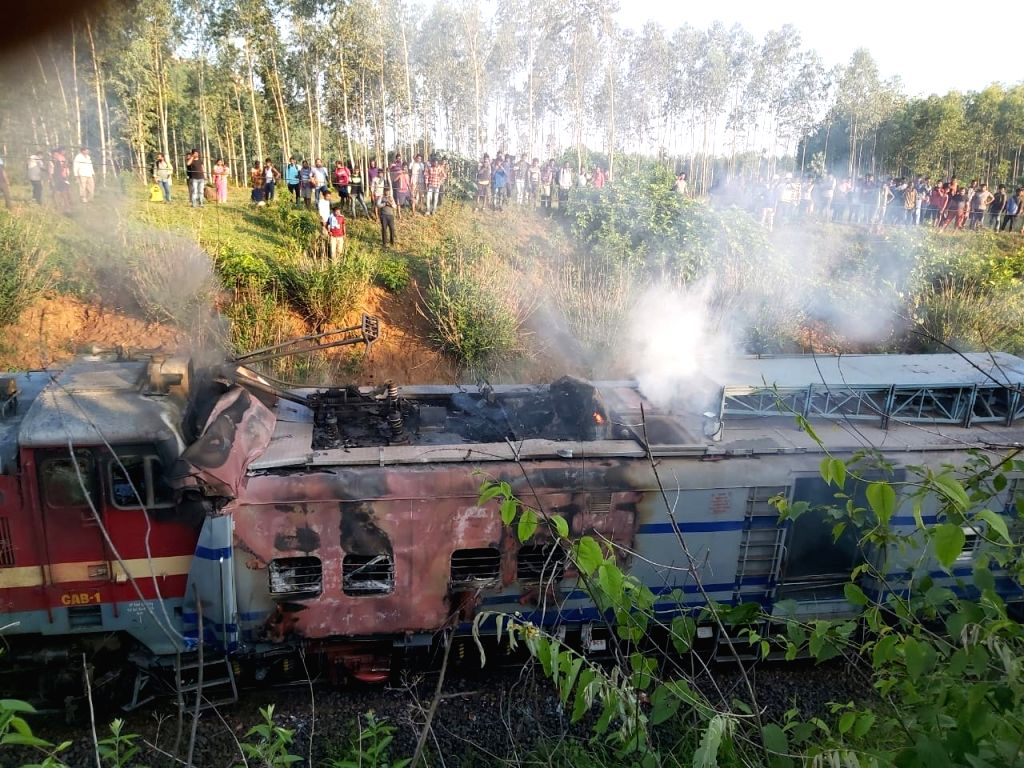 Rayagada: The Howrah-Jagadalpur Samaleshwari Express' the engine of which caught fire after the train rammed into a tower car engaged in repair work between Singapur Road and Keutguda in Odisha's Rayagada district on June 25, 2019. Suresh, a technici
