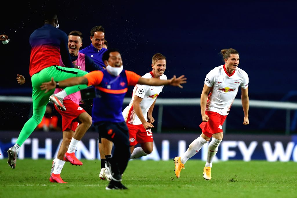 RB Leipzig celebrate victory after the 2019-2020 UEFA Champions League quarter final match between RB Leipzig and Atletico Madrid in Lisbon, Portugal, Aug. 13, 2020.