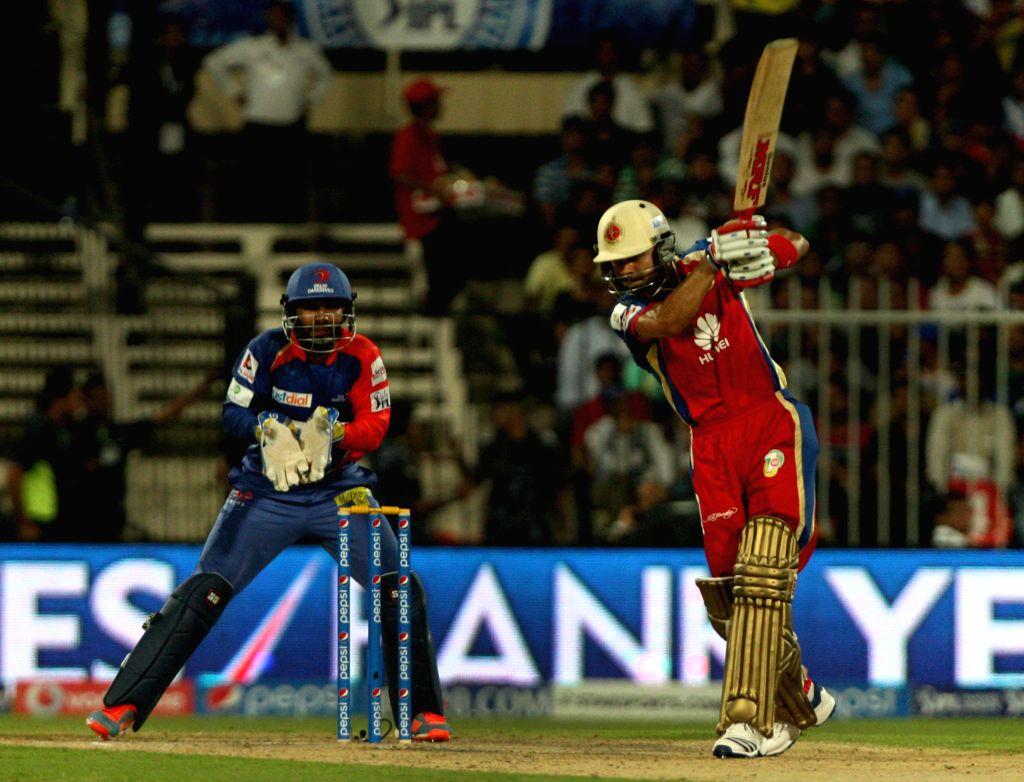 RCB captain Virat Kohli in action during the second match of IPL 2014 between Delhi Daredevils and Royal Challengers Bangalore, played at Sharjah Cricket Stadium in Sharjah of United Arab Emirates on - Virat Kohli