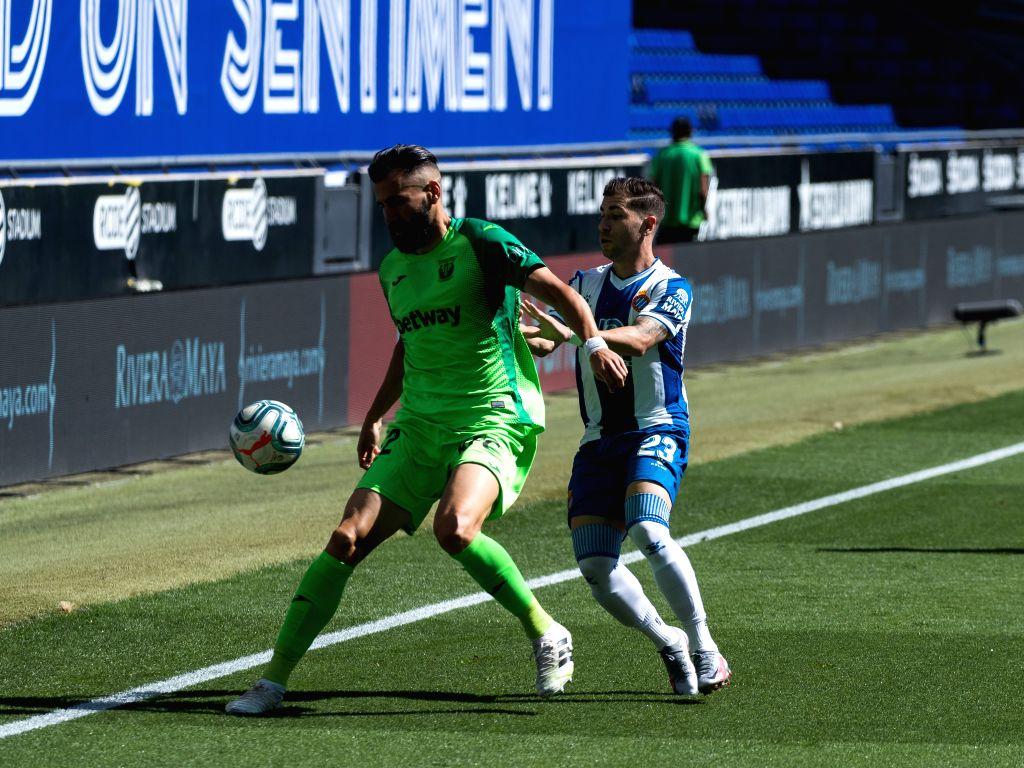 RCD Espanyol's Adrian Embarba (R) vies with Leganes' Dimitri Siovas during a Spanish league football match between RCD Espanyol and Leganes in Barcelona, Spain, ...