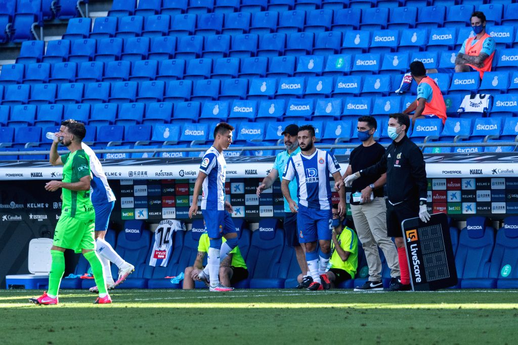 RCD Espanyol's Wu Lei (3rd L) is replaced by Jonathan Calleri (3rd R) during a Spanish league football match between RCD Espanyol and Leganes in Barcelona, Spain, ...
