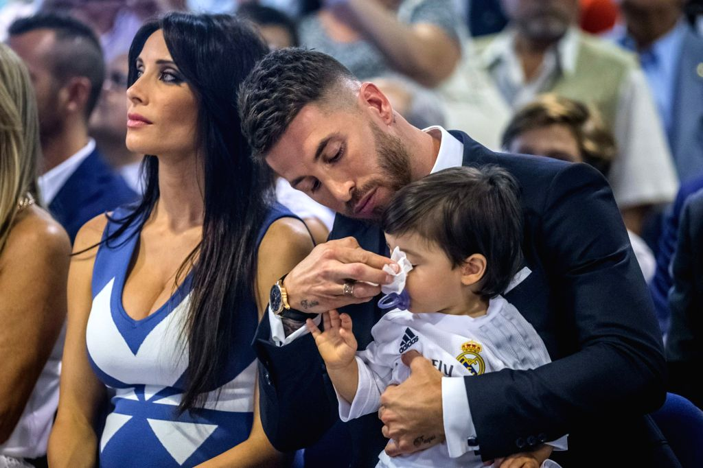 Real Madrid's captain, Spanish defender Sergio Ramos (R), next to girlfriend Pilar Rubio and their son, during the renewal ceremony with his team at Santiago Bernabeu stadium in Madrid, Spain, 17 ...
