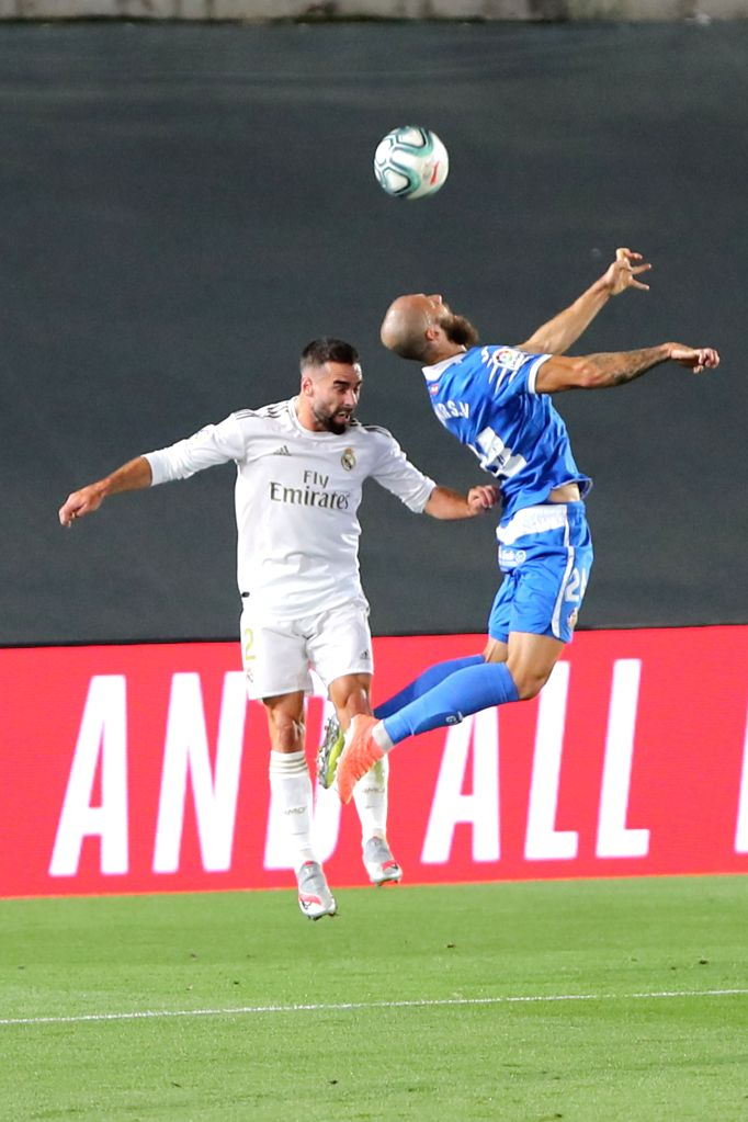 Real Madrid's Dani Carvajal (L) and Getafe's David Timor vie for the ball during a Spanish league football match between Real Madrid and Getafe in Madrid, Spain, July ...