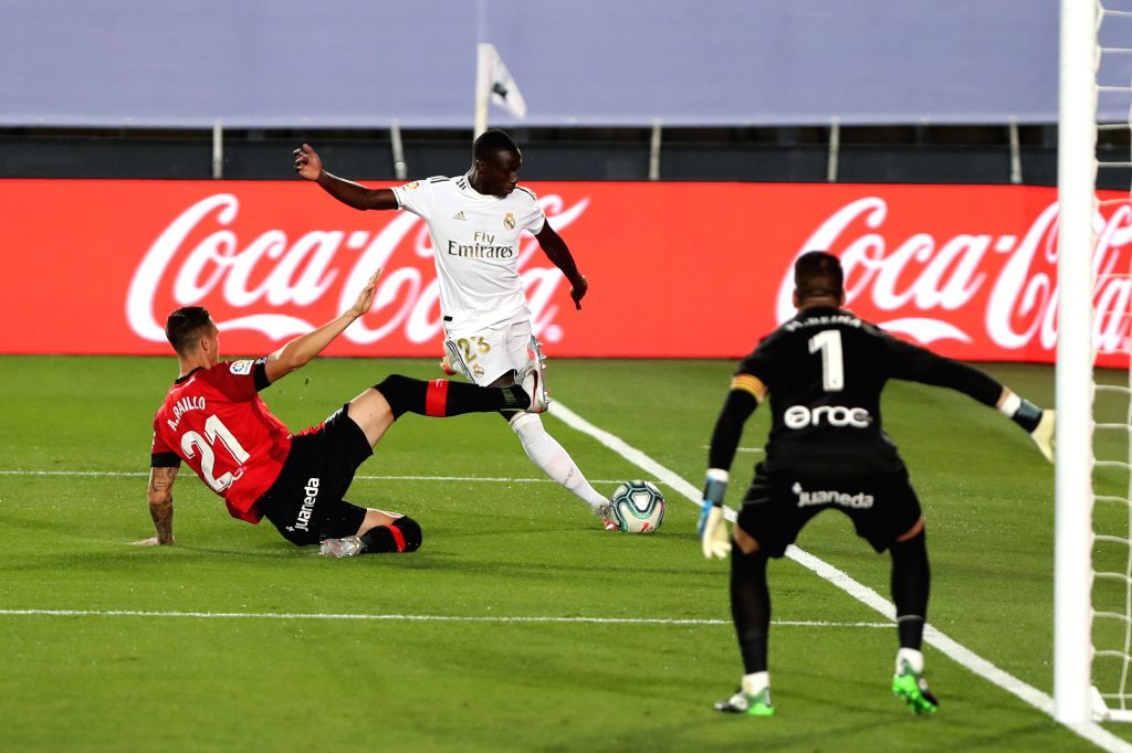 Real Madrid's Ferdinand Mendy (C) vies with Mallorca's Antonio Raillo during a Spanish league football match between Real Madrid and Mallorca in Madrid, Spain, June ...
