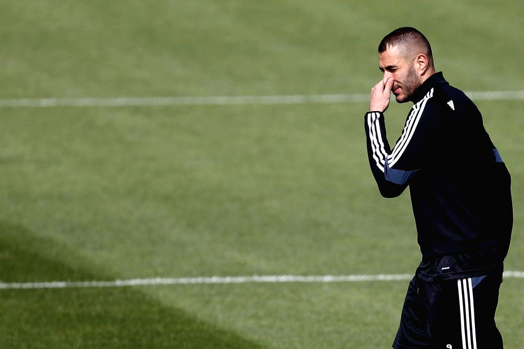 Real Madrid's French forward Karim Benzema attends a training session held at the team's sports complex in Valdebebas, Madrid, Spain, 13 April 2015. Real Madrid will face Atletico Madrid in a UEFA ...