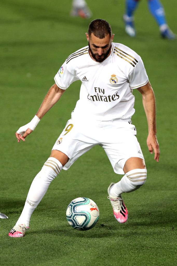 Real Madrid's Karim Benzema competes during a Spanish league football match between Real Madrid and Getafe in Madrid, Spain, July 2, 2020.