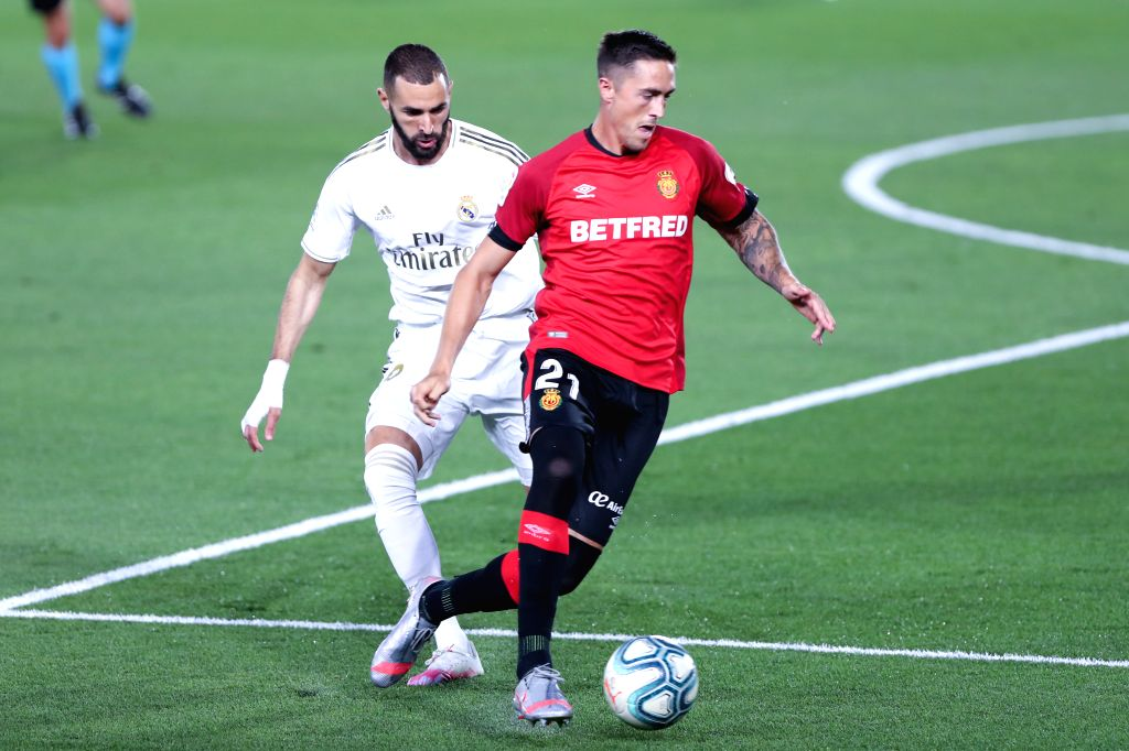 Real Madrid's Karim Benzema (L) vies with Mallorca's Antonio Raillo during a Spanish league football match between Real Madrid and Mallorca in Madrid, Spain, June ...