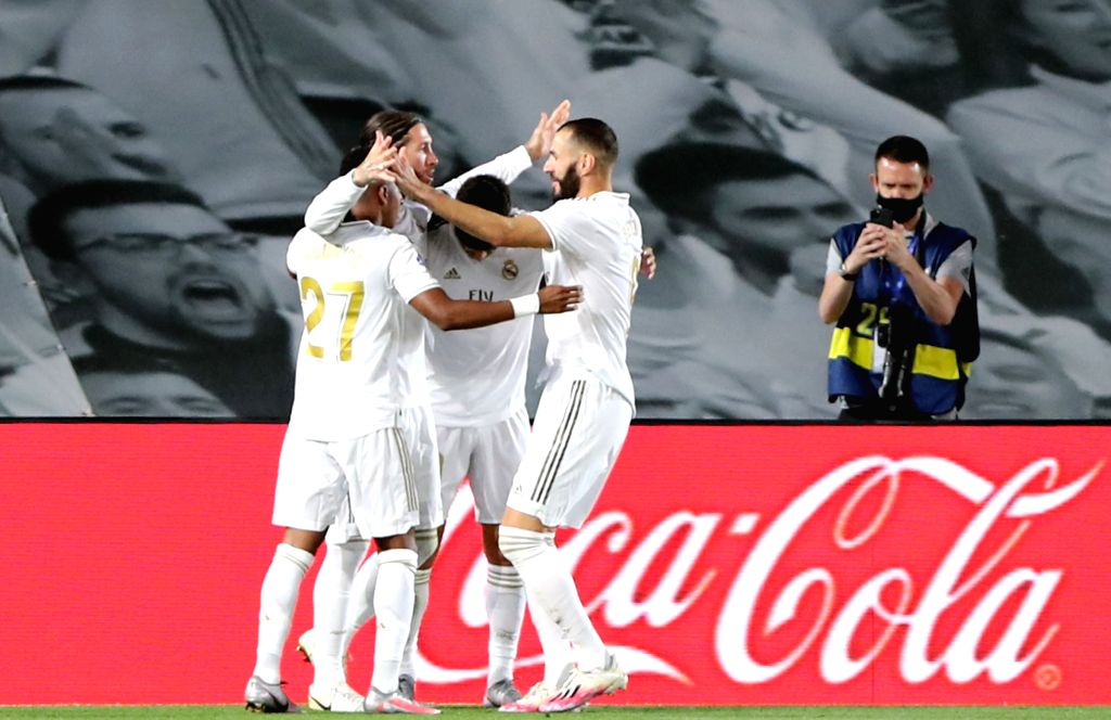 Real Madrid's players celebrate after scoring a penalty during a Spanish league football match between Real Madrid and Getafe in Madrid, Spain, July 2, 2020.