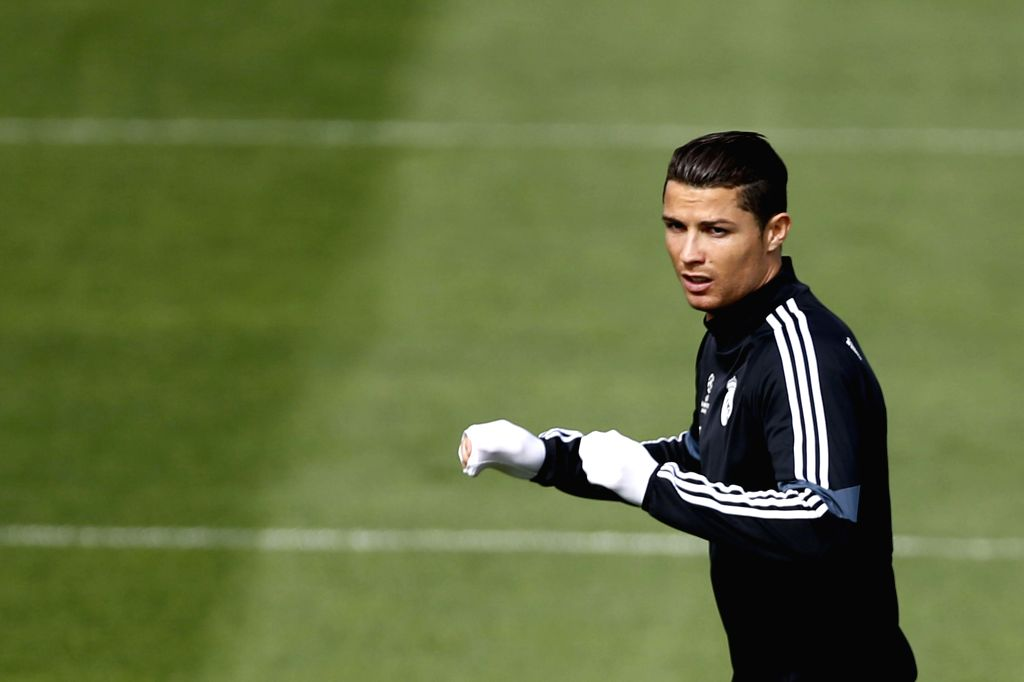 Real Madrid's Portuguese forward Cristiano Ronaldo attends a training session held at the team's sports complex in Valdebebas, Madrid, Spain, 13 April 2015. Real Madrid will face Atletico Madrid in a ...