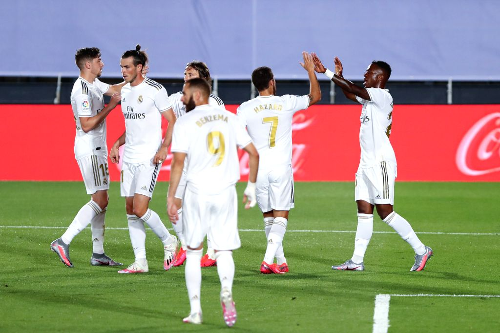 Real Madrid's Vinnicius Jr. (1st R) celebrates scoring with teammates during a Spanish league football match between Real Madrid and Mallorca in Madrid, Spain, June ...
