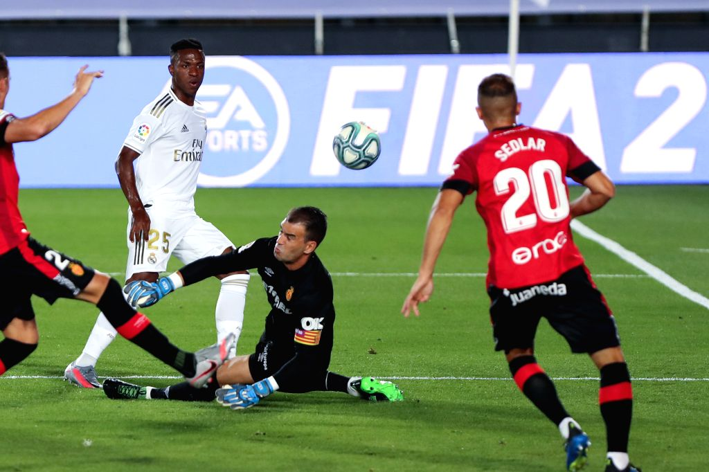 Real Madrid's Vinnicius Jr. (3rd R) scores during a Spanish league football match between Real Madrid and Mallorca in Madrid, Spain, June 24, 2020.