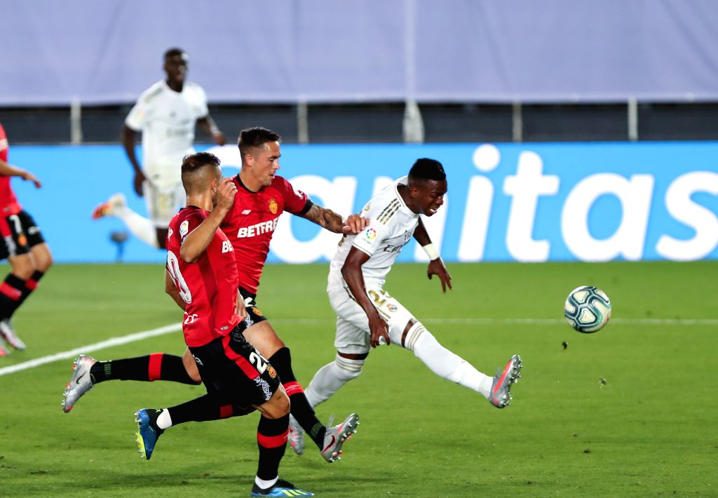 Real Madrid's Vinnicius Jr. (R) shoots during a Spanish league football match between Real Madrid and Mallorca in Madrid, Spain, June 24, 2020.
