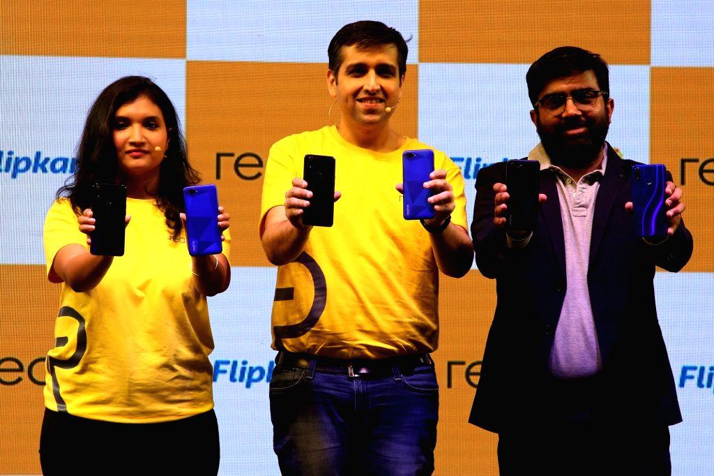 Realme India Product Manager Nidhi Bhatia, Realme CEO Madhav Sheth and Flipkart Senior Director (Mobiles) Aditya Soni at the launch of Realme 3 Pro and Realme C2 smartphones, in New Delhi ...