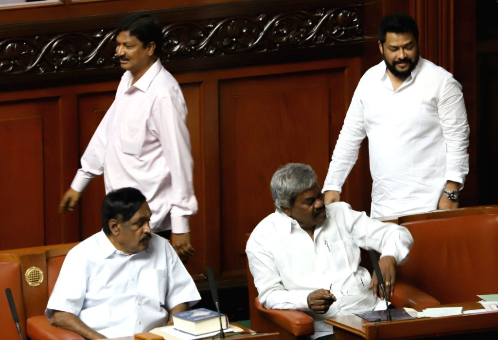 Rebel Congress legislators Ramesh Jarkiholi and B Nagendra during budget session at Karnataka Assembly in Bengaluru, on Feb 13, 2019.