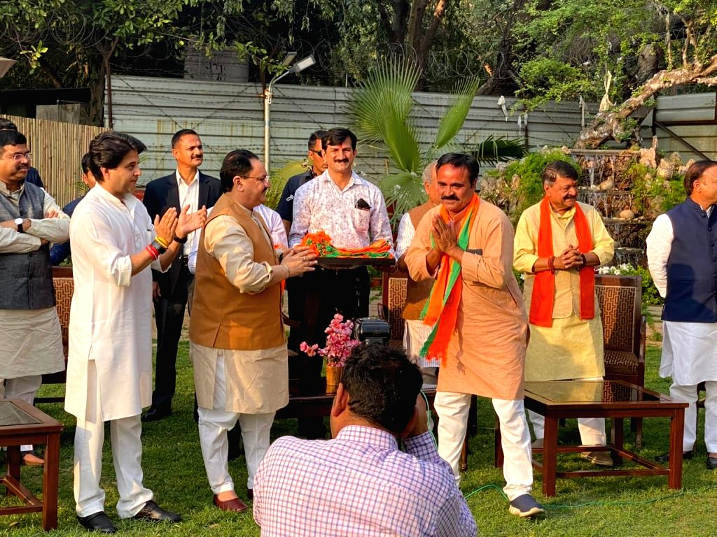 Rebel Congress MLAs of Madhya Pradesh meet BJP President JP Nadda in the presence of BJP leader Jyotiraditya Scindia, in New Delhi on March 21, 2020. The 22 Congress legislators, including ...