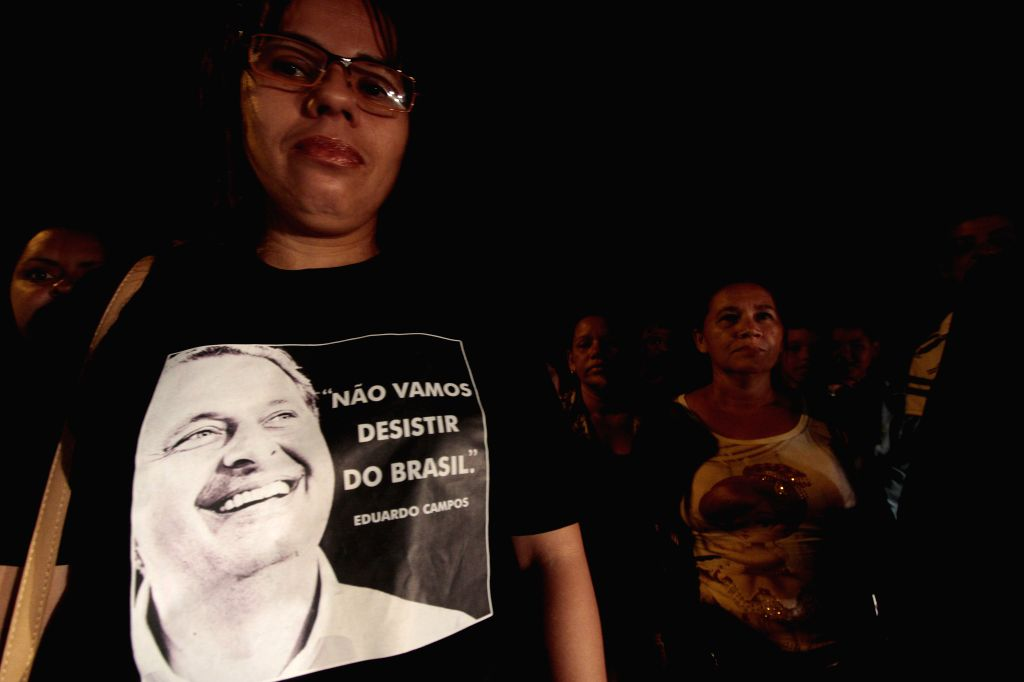 A supporter of late presidential candidate Eduardo Campos waits in the Recife Air Base in the city of Recife, Brazil, on Aug 16, 2014. According to local press, the .