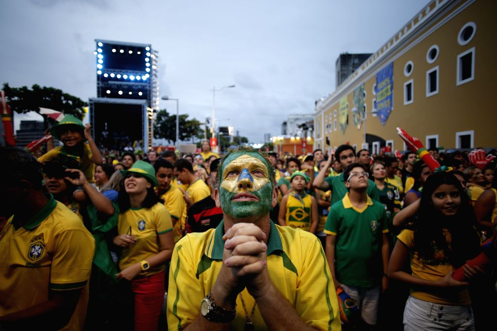 Brazilian Fans react while watching the game between Brazil and Cameroon in the FIFA Fan Fest in Recife, Brazil, June 23, 2014.