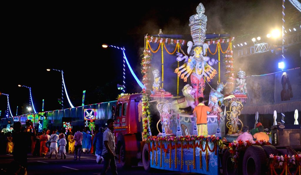 Red Road Carnival organised showcase award-winning Durga idols of the year underway in Kolkata on Oct 3, 2017.