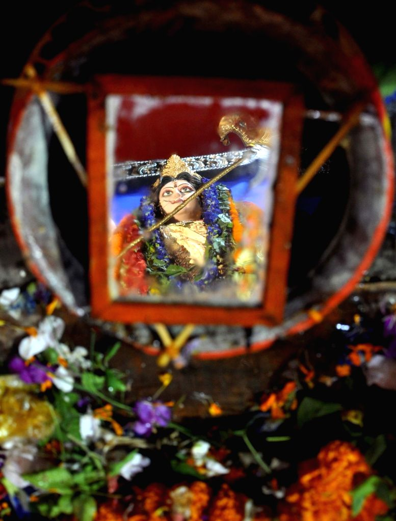 Reflection of Goddess Durga in a mirror used in the rituals in Kolkata, on Oct 11, 2016.