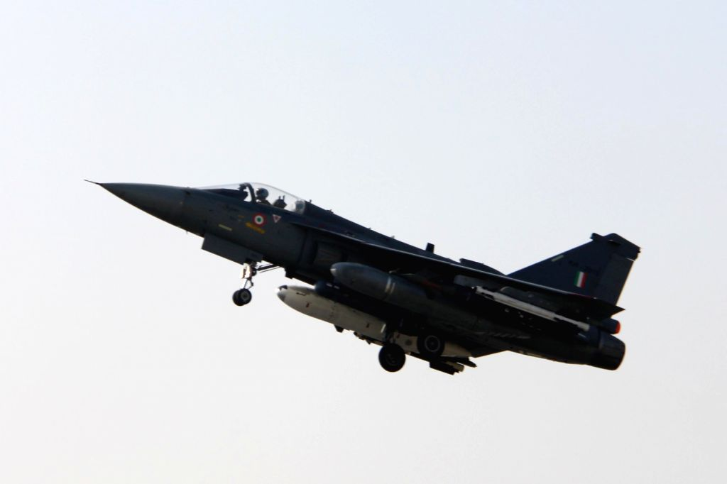 Regarded as the smallest and the lightest combat jet in the world, the indigenously-designed Tejas during initial operational clearance (IOC-II) test in Bangalore on Dec.20, 2013.