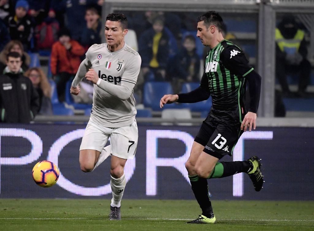 REGGIO EMILIA, Feb. 11, 2019 - Juventus' Cristiano Ronaldo (L) competes during a Serie A soccer match between Sassuolo and FC Juventus in Reggio Emilia, Italy, Feb. 10 , 2019. FC Juventus won 3-0.