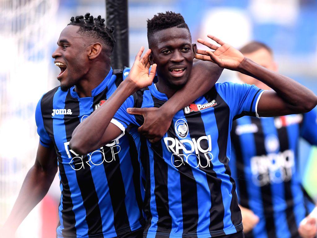 REGGIO EMILIA, May 12, 2019 - Atalanta's Musa Barrow (R) celebrates scoring during a Serie A soccer match between Atalanta and Genoa in Reggio Emilia, Italy, May 11, 2019. Atalanta won 2-1.