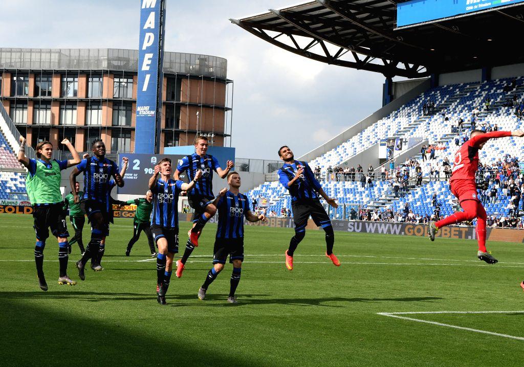 REGGIO EMILIA, May 12, 2019 - Atalanta's players celebrate at the end of during a Serie A soccer match between Atalanta and Genoa in Reggio Emilia, Italy, May 11, 2019. Atalanta won 2-1.