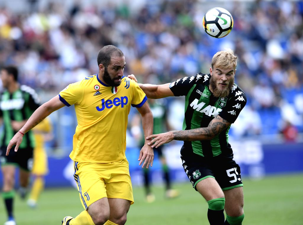 REGGIO EMILIA, Sept. 18, 2017 - Juventus' Gonzalo Higuain(L) competes with Sassuolo's Timo Letschert during a Serie A soccer match between Juventus and Sassuolo in Reggio Emilia, Italy, Sept. 17, ...