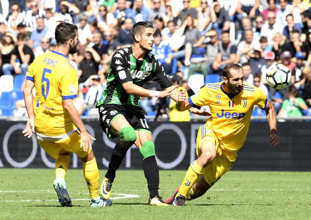 REGGIO EMILIA, Sept. 18, 2017 - Juventus' Miralem Pjanic(L), Giorgio Chiellini(R) competes with Sassuolo's Diego Falcinelli during a Serie A soccer match between Juventus and Sassuolo in Reggio ...